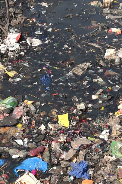 clean drinking lake and river water contaminated by trash garbage and chemicals
