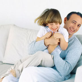 family happy father with laughing child