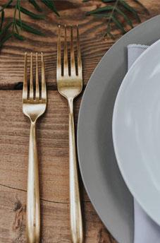 cutlery flatware gold fork silverwear on wood table